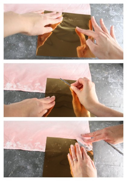 Placing gold foil on fabric