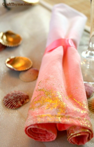Ombre fabric with gold leaf edging turned into a napkin