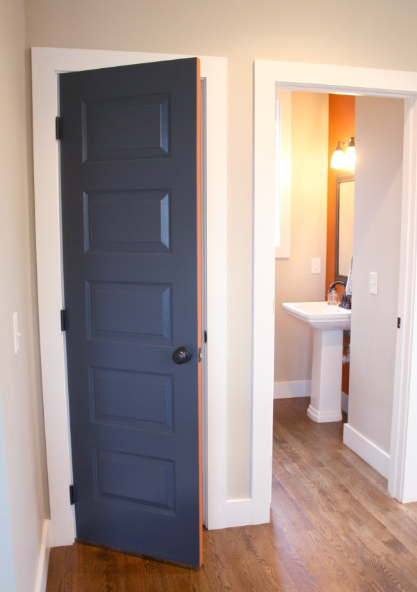Navy blue door with orange accent