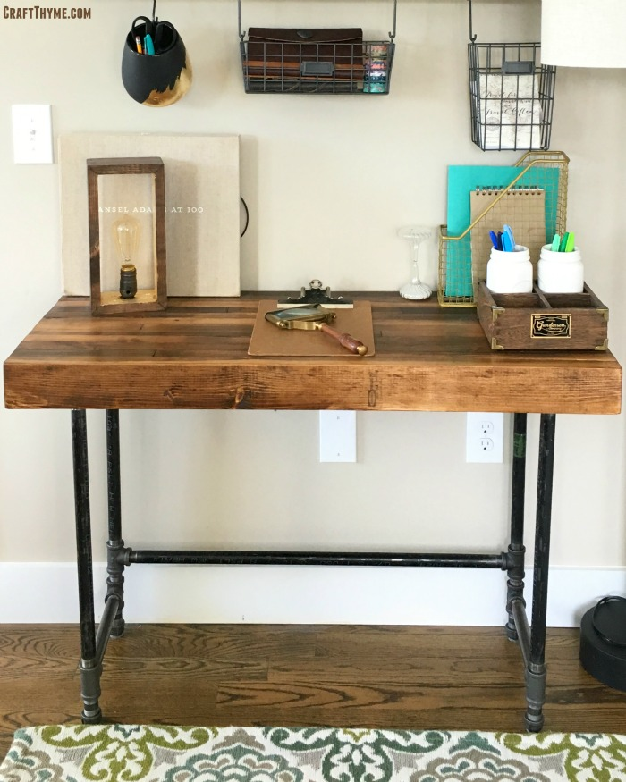 Pipe legged desk and stacked wood top. Tutorial included.