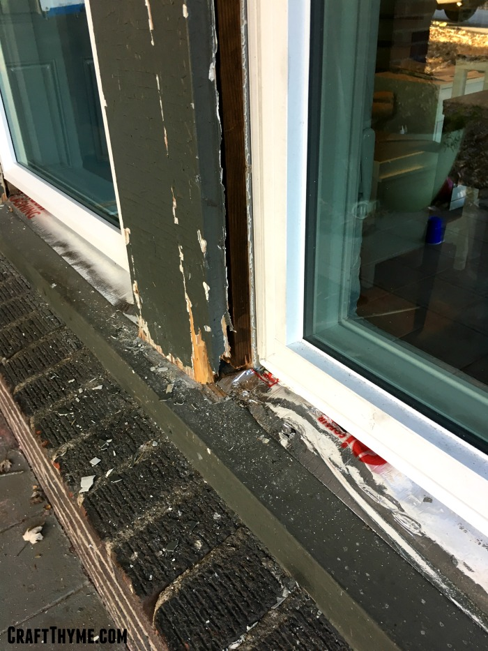Damage to old trim prior to metal window cladding.
