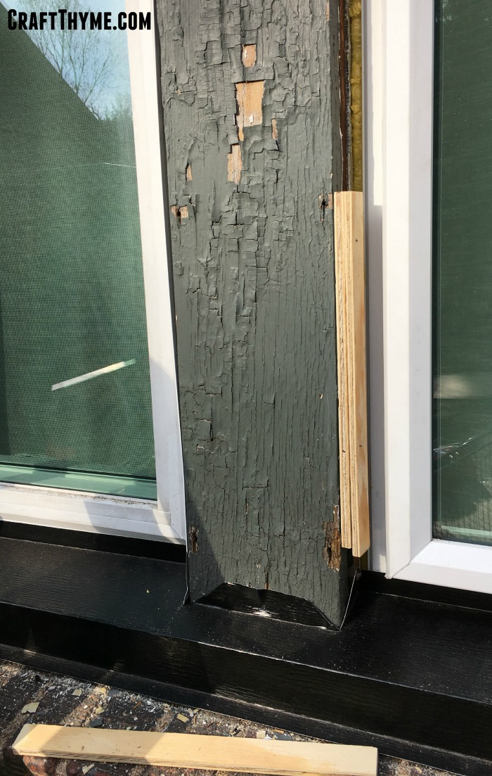 Shims are inserted on the exterior of these replacement windows to correctly apply metal window capping.