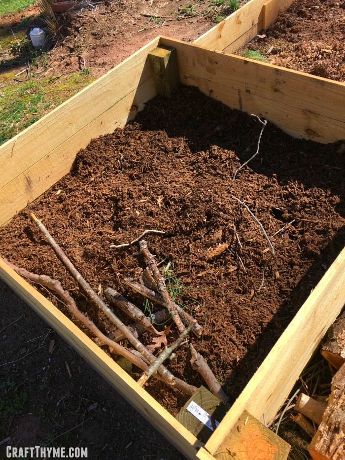 How to use rotting wood chips to keep moisture in the bottom of your raised beds