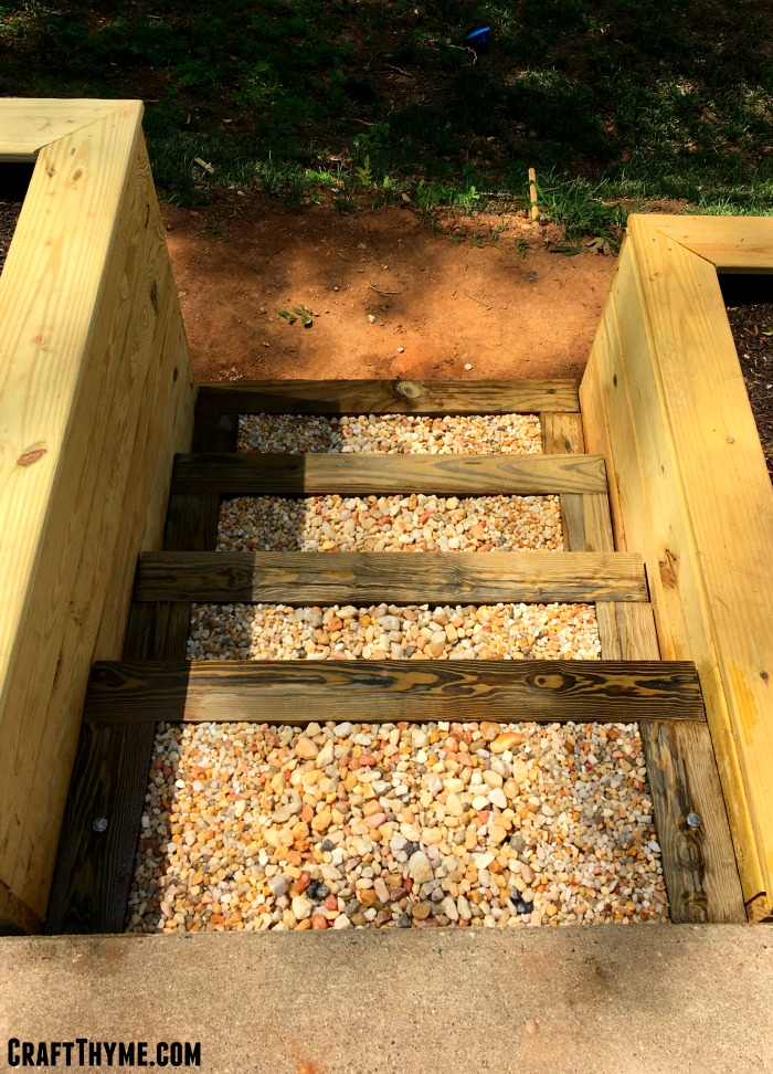 Top view of completed DIY timber and pea gravel stairs we put in out raised garden beds.