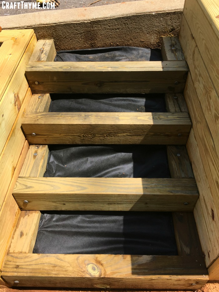 Adding a permeable barrier to the pea gravel and timber stairs