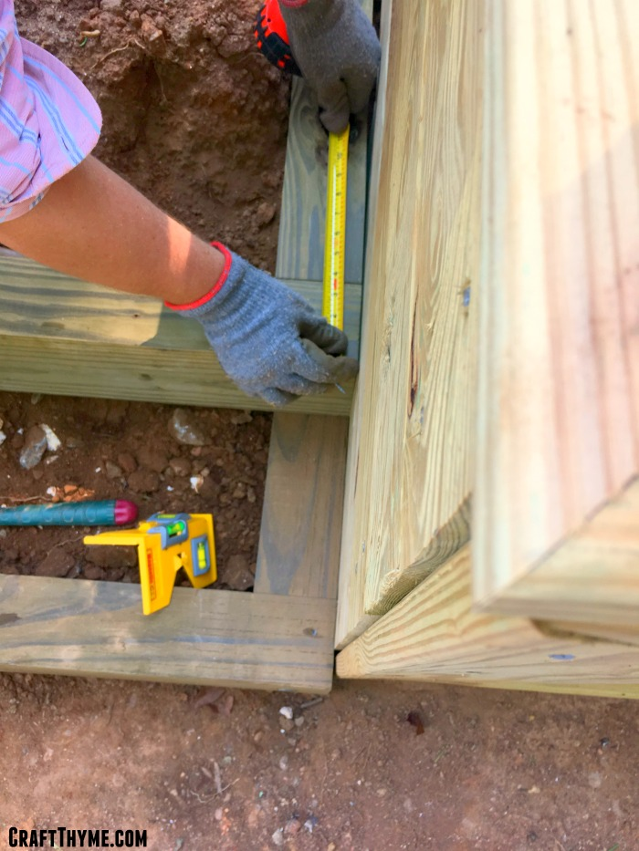 Measuring the depth in our outdoor timber staircase