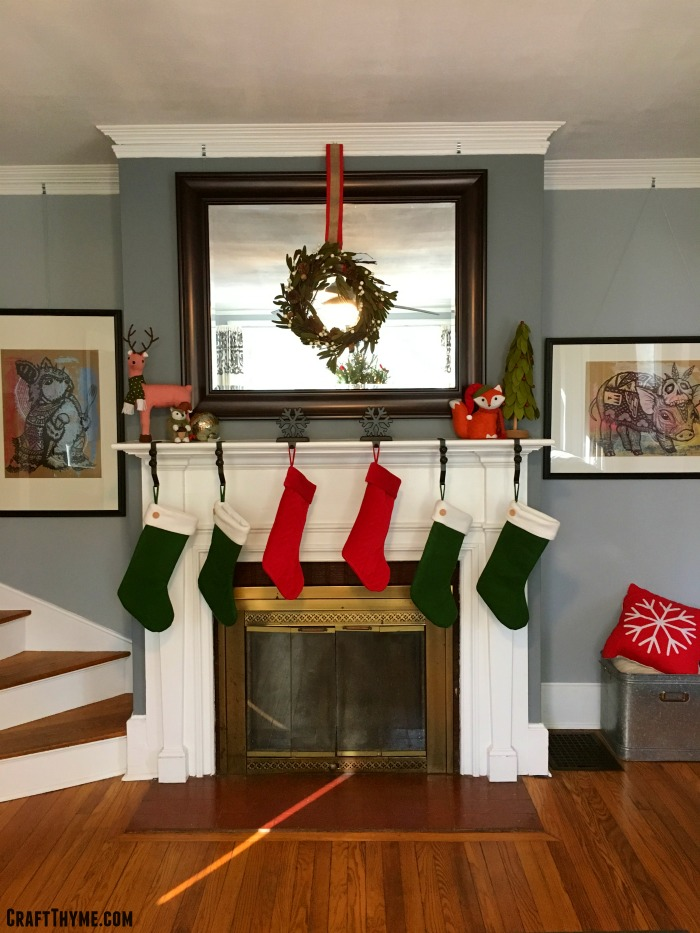 Traditional red and green stockings hung with felt woodland Christmas decorations